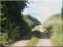 SH3434 : Track leading north from the A499 towards the Stad Cynfil Housing Estate by Eric Jones