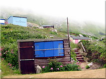 SY6873 : Beach huts and low cloud - Chesil Cove by Sarah Smith