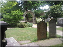 TQ2075 : Tombs and archway in St Mary the Virgin Churchyard, Mortlake by Marathon