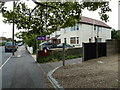 TQ1603 : Road and path junction in Brougham Road by Basher Eyre