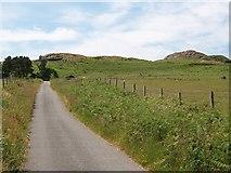 SH3033 : Country road below Garn Saethon Hill by Eric Jones