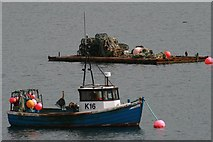ND4798 : Fishing Boat and Lobster Creels, Weddell Sound, Orkney by Becky Williamson
