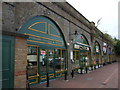 TQ4973 : Shops beneath railway line at Bexley by Richard Hoare