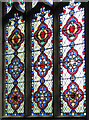 TF8730 : St Peter's church in Dunton - Victorian glass by Evelyn Simak