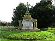 TM5286 : St Edmund's church in Kessingland - war memorial by Evelyn Simak
