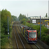 SO9596 : Tram approaching Bilston Central Station, Wolverhampton by Roger  Kidd