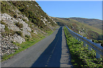 SH9124 : Mountain road under Craig yr Ogof by Nigel Brown