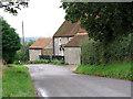 TG1340 : Flint and brick cottage in Sheringham Road, West Beckham by Evelyn Simak