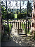 TQ1352 : South gate leading from the rose garden  to the herbaceous border and the croquet lawn by pam fray