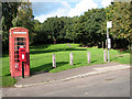 TG3312 : Bus stop, phone box and postbox at Pedham Green by Evelyn Simak
