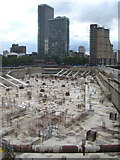 TQ3680 : Mothballed construction site at Westferry Circus by Rod Allday