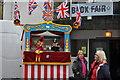 SS9522 : Bampton : Punch & Judy at Bampton Fair by Lewis Clarke
