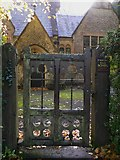 TQ1450 : The gate at St Barnabas Old School at Ranmore by Shazz