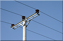NT4630 : Power lines and insulators by Walter Baxter