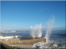 J3730 : Waves breaking against the walls of the Rock Pool Baths by Eric Jones