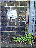 TQ4077 : Benchmark on wall pier outside Sherington Primary School by Roger Templeman
