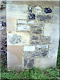 TQ5380 : Benchmark on buttress of church of St Mary and St Peter by Roger Templeman