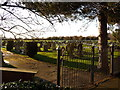 TL4889 : Manea: cemetery gate by Chris Downer