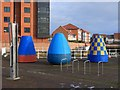NZ4058 : Painted buoys, Sunderland Marina esplanade by Andrew Curtis
