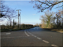 TM3071 : Road junction on the B1117 near Rowe's Hill by Adrian S Pye