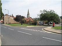 TM2850 : Looking towards the parish church from The Street by Basher Eyre