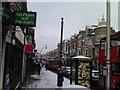 TQ4386 : A snowy view of Cranbrook Road by Robert Lamb