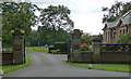 NZ1082 : Lodge and gates near Bolam by Stephen Richards