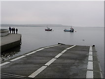 SZ1891 : Mudeford: lifeboat slipway and Christmas strollers by Chris Downer