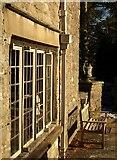 SX7962 : Window, seat and urn, Dartington by Derek Harper