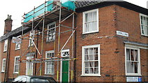 TM3877 : Scaffolding on a house near the junction of London Road and Steeple End by Basher Eyre