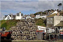 SW9980 : Lobster Pots on the Harbourside by Tony Atkin