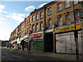 TQ4077 : Shops at the Royal Standard (1) by Stephen Craven