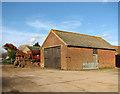 TG3607 : Brick barn by Hill Farm, South Burlingham by Evelyn Simak