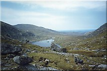 NG9980 : Loch Toll a'Mhadaidh by Roger