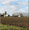 TG0336 : Cottages and All Saints church, Sharrington by Evelyn Simak