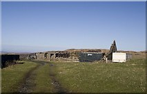 NR3758 : Ruined outbuildings and a caravan at Kynagarry, Islay by Becky Williamson