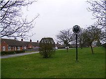 TM3864 : Kelsale & Carlton Village Sign by Adrian Cable
