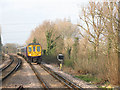 TQ2565 : Train approaching Sutton Common by Stephen Craven