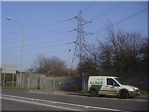 TQ0485 : Pylon by Denham roundabout by David Howard