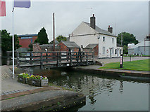 SO8453 : Swing bridge and old cottage, Diglis Basin in Worcester by Roger  Kidd