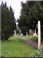TM2653 : Footpath to Caters Road & Scott's Lane at St.Andrew's Church by Adrian Cable