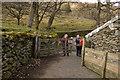 NY5012 : Footpath through farmyard at Swindale Head by Tom Richardson