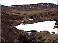 NN6870 : Allt Poll Tairbh Shios emerging from Poll Tairbh above Dalnaspidal by ian shiell