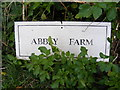 TM3957 : Abbey Farm sign by Adrian Cable