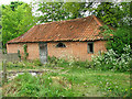 TG0834 : Old brick outbuilding, Edgefield by Evelyn Simak