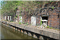 SJ8844 : Former canal side works by Mike Todd