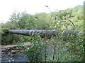 ST0491 : Pipe across the River Rhondda, Trehafod by Jaggery