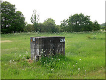 TL4311 : Sewer manhole in a field by Stephen Craven
