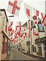 SW9175 : Flags in Lanadwell Street, Padstow by Derek Harper