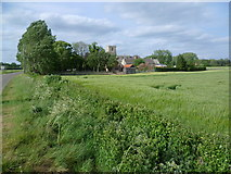 TF1107 : St Peter's Church, Maxey across the fields by Marathon